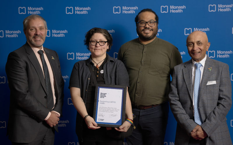 Award Winners with Chief Executive Andrew Stripp and Board Chair Dipak Sanghvi.  Award: Supporting LGBTIQ Health    Images from the 2019 Monash Health Awards, held at lecture theatre 1 at Monash Medical Centre, Clayton. Copyright Monash Health. Not for use without prior written permission.